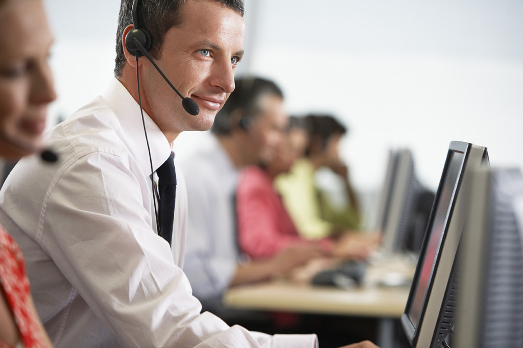 Customer Service Representatives Using Headset Microphones